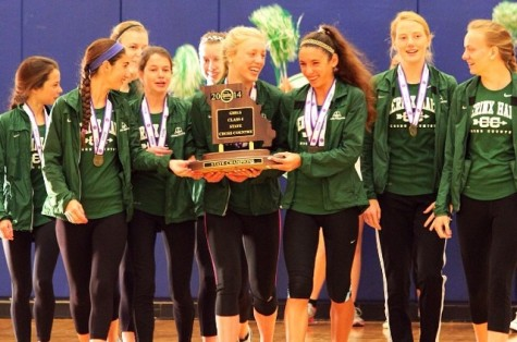 The cross country team shows off award during pep rally