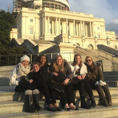Nerinx girls sit on the steps of the Capital Building.