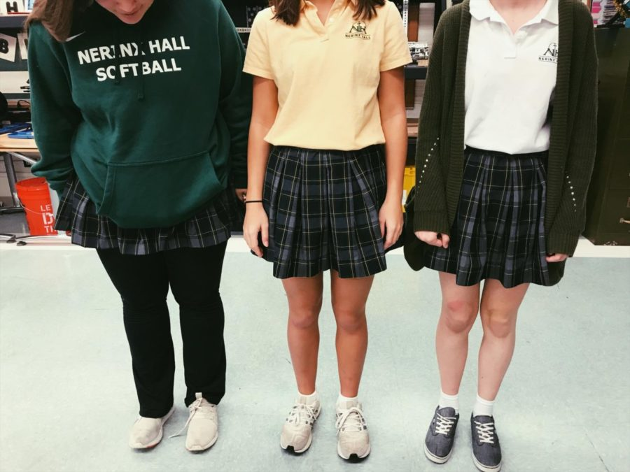 Juniors Ava Neels, Claire Teng, and Hannah Dillon show off their varying uniforms
